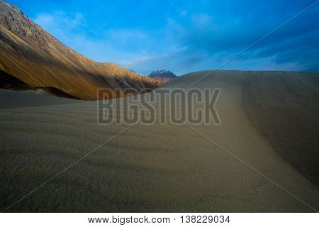 Sand Dunes Against The Background Of Distant Colorful Mountain Range And Sunrise Sky, Ladakh, Himala