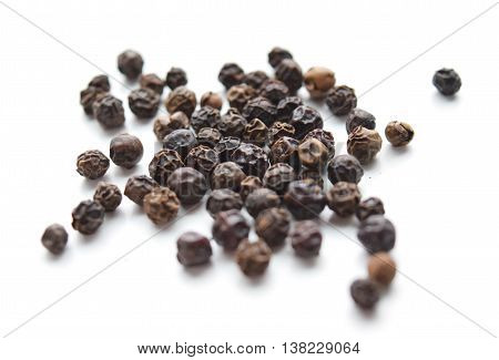 Black peppercorns macro isolated, spices for health