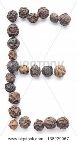 Black peppercorns organized as the letter E isolated