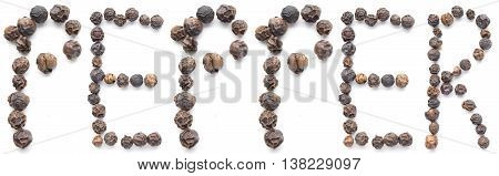 Black peppercorns organized to spell out the word