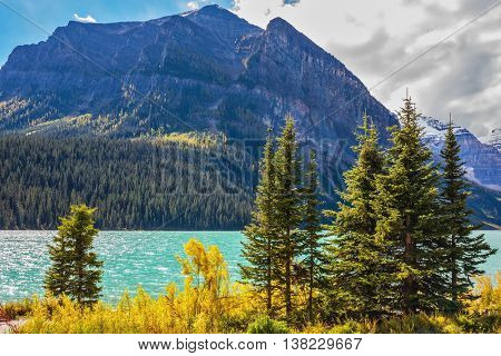 The Rocky Mountains, Canada, Banff National Park. The magnificent lake Louise in an environment of glaciers. Excellent sunny day