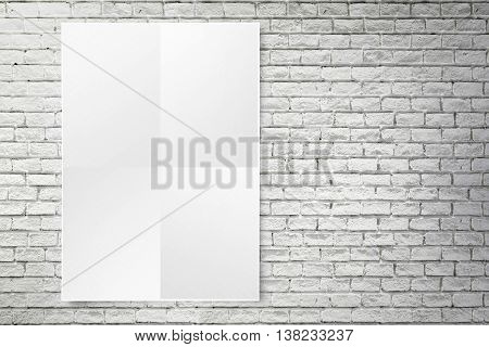Blank Folded Paper Poster Hanging On White Brick Wall,template Mock Up For Adding Your Design