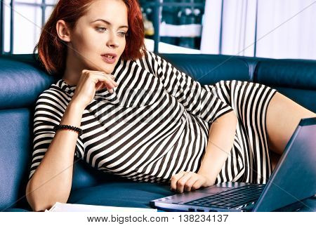 Red-haired Young Business Woman Or Student Girl Working With Computer At Indoor