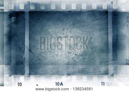 Film negative frames on blue background