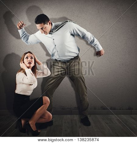 Violent and angry man intimidates a frightened woman