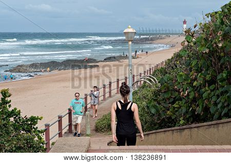 DURBAN SOUTH AFRICA - JULY 09 2016: Locals and tourists on the promenade near the Millennium Pier in Umhlanga Rocks