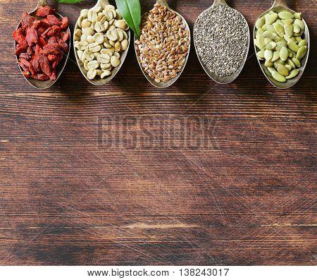 healthy eating ingredients super food - chia and flax seeds, goji berries, nuts