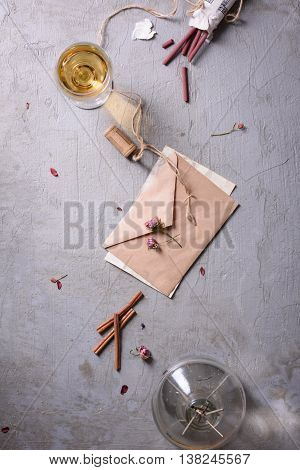 Wedding or valentine's day concept. Love letter or romantic message.Top view,copy space. Wine, aroma sticks over grey background.
