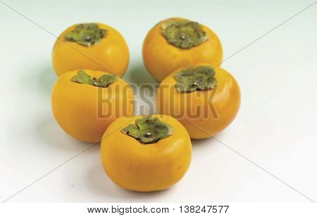 Several fresh persimmons