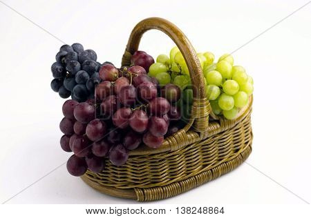 Colorful fresh grapes in basket