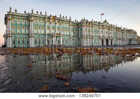 The Winter Palace, the Hermitage Museum is reflected in the water at the Palace Square autumn morning October 4, 2015 in St. Petersburg, Russia.