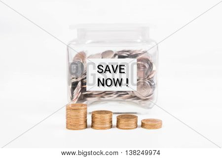 piggy bank pile gold coin with word text save money now on paper in glass piggy bank.(business bank and finance concept)