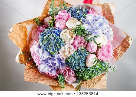 flower composition with hydrangea and peonies. Kraft paper. crisp packaging