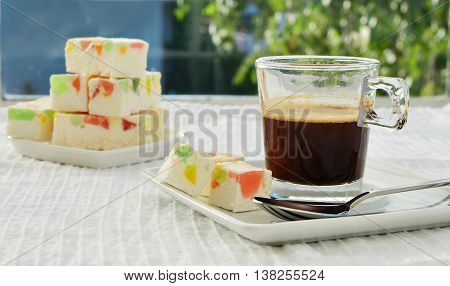 Gumdrop white chocolate fudge with a cup of coffee