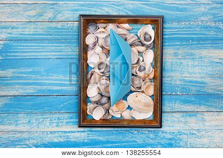 Blue Paper Boat And Sea Shells In Photo Frame