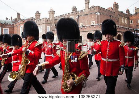 LONDON - JUNE 21, 2016: The colorful changing of the guard ceremony at Buckingham Palace on June 21 in London, UK. It is one of England's most popular visitor attractions.