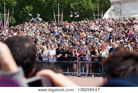 LONDON -JUNE 21, 2016: The colorful changing of the guard ceremony at Buckingham Palace  in London, UK. It is one of England's most popular visitor attractions.