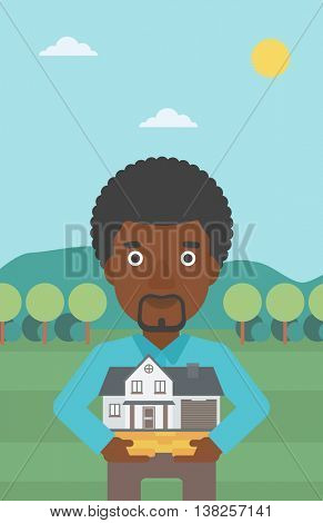 An african-american man holding house model in hands on the background of mountains. Real estate agent with house model. Vector flat design illustration. Vertical layout.