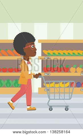 An african-american woman pushing empty supermarket cart. Woman shopping at supermarket with cart. Woman walking with trolley on aisle at supermarket. Vector flat design illustration. Vertical layout.