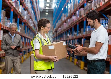 Focus on workers are working together in a warehouse