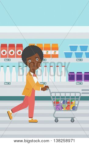 An african-american young woman pushing a supermarket cart with some goods in it. Customer shopping at supermarket with cart full with groceries. Vector flat design illustration. Vertical layout.