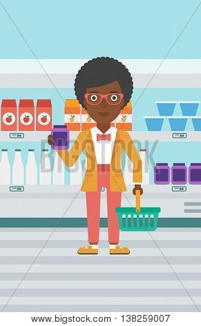 An african-american woman holding shopping basket in one hand and milk product in the other. Female customer shopping at supermarket with basket. Vector flat design illustration. Vertical layout.
