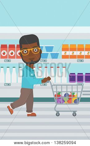 An african-american young man pushing a supermarket cart with some goods in it. Customer shopping at supermarket with cart. Vector flat design illustration. Vertical layout.