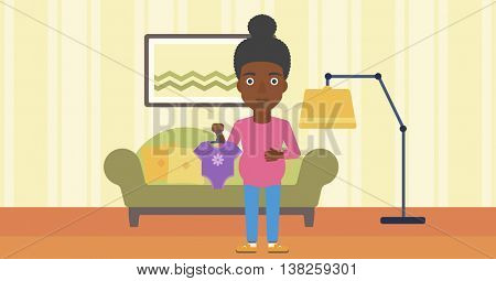 An african-american pregnant woman holding clothes for her baby. Pregnant woman with bodysuit for baby. Pregnant woman with presents at baby shower. Vector flat design illustration. Horizontal layout.