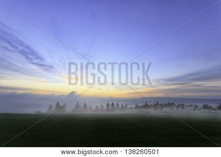 Sunset on a Golf course with mist