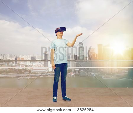 3d technology, virtual reality, entertainment, cyberspace and people concept - man with virtual reality headset or 3d glasses playing game holding something on palm over singapore background