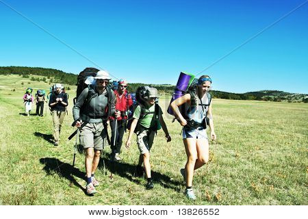 Backpackers going up in Crimean mountain