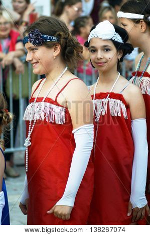 Montenegro, Herceg Novi - 04/06/2016: Young performers dance the Charleston, dressed in retro style. 10 International Children's Carnival