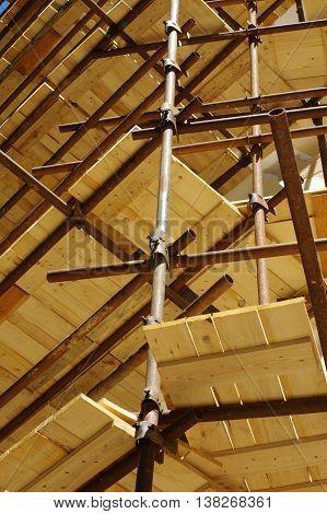 Scaffolding buildings equipment wooden floorboards industry theme.