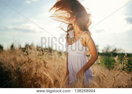 Beautiful woman in barley fields enjoying freedom