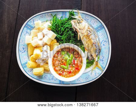 Chili sauce mackerel fried and boiled vegetables Thai food.