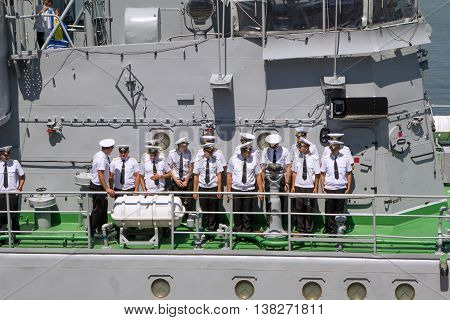 Odesa, Ukraine - July 03, 2016: Crew of warship 'Yuri Olefrienko' stands on their deck of a ship and preparing to meet the President of Ukraine Petro Poroshenko during celebration of NAVY day in Odesa