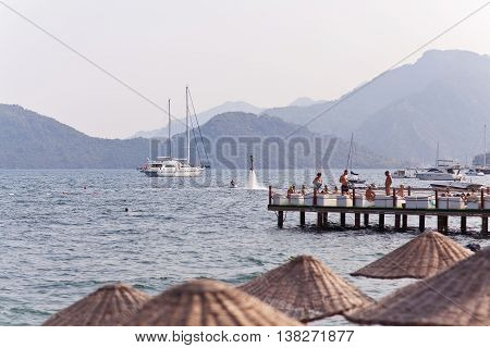 MARMARIS TURKEY - September 19 2015: Unidentified people relaxing on the Aegean coast