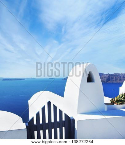 Terrace on Santorin island with a view on azure Mediterranean sea. Beautiful sky and horizon.