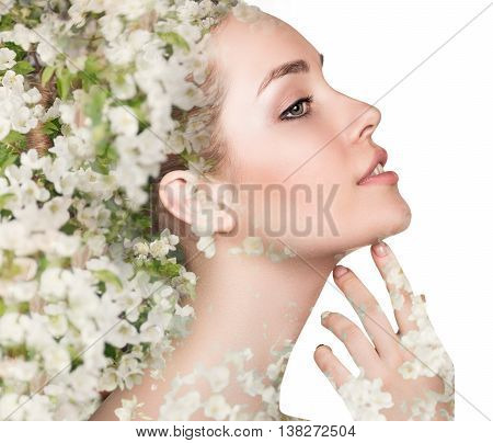 Young woman over blooming tree floral pattern and double exposure effect over white background