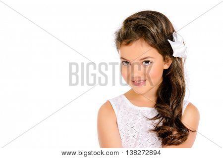 Pretty eight-year girl wearing white dress. Studio shot. Kid's beauty, fashion. Isolated over white.