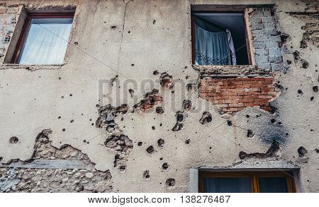 Mostar Bosnia and Herzegovina - August 25 2015. Wall building with bullet holes from Bosnian War period in Mostar