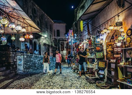 Mostar Bosnia and Herzegovina - August 25 2015. Paople walk among souvenirs shops on the Old Town of Mostar