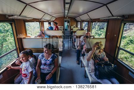 Serbia - August 28 2015. Tourists travels old narrow gauge railway called Sargan Eight running from the village of Mokra Gora to Sargan Vitasi
