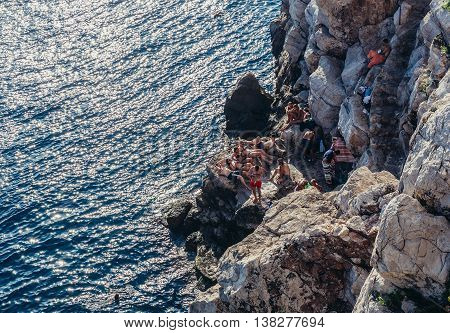 Dubrovnik Croatia - August 26 2015. Tourists gathers on the rocks in Dubrovnik city