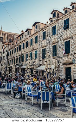 Dubrovnik Croatia - August 26 2015. People sits in restaurant on the Old Town of Dubrovnik