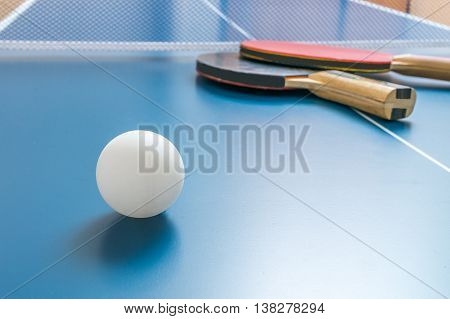 White Ball For Table Tennis Or Ping Pong On Wooden Table.