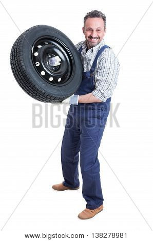Professional Smiling Mechanic Working With Car Tire