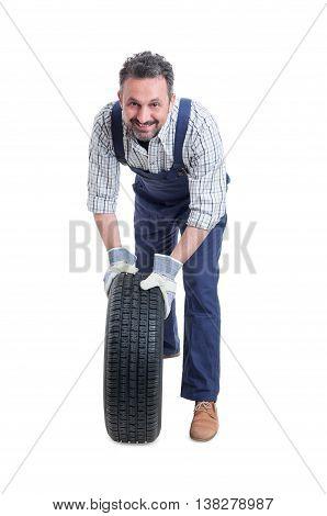 Handsome Mechanic In Workshop Changing Car Wheel