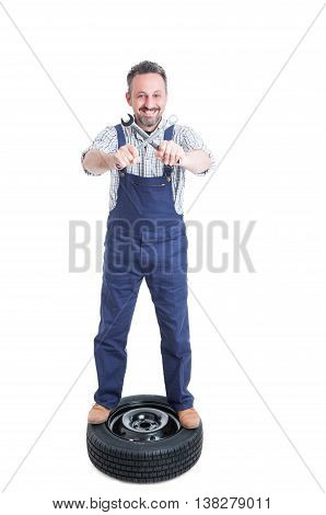 Joyful Repairman On Tire Holding Crossed Wrench