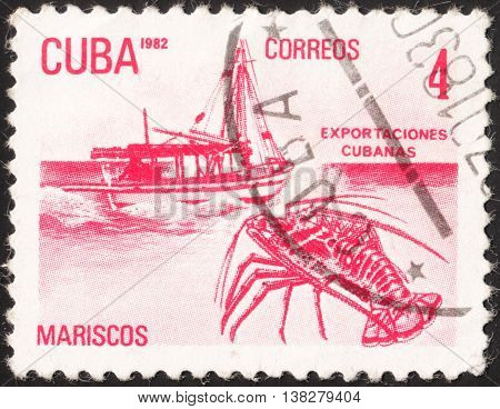 MOSCOW RUSSIA - JANUARY 2016: a post stamp printed in CUBA shows a boat and a lobster (Mariscos) the series